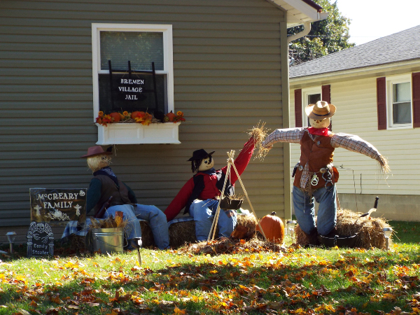 scarecrows next to building